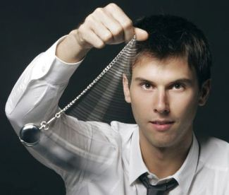 Businessman holding a pocket watch and swinging it in the fashion of a hypnotist